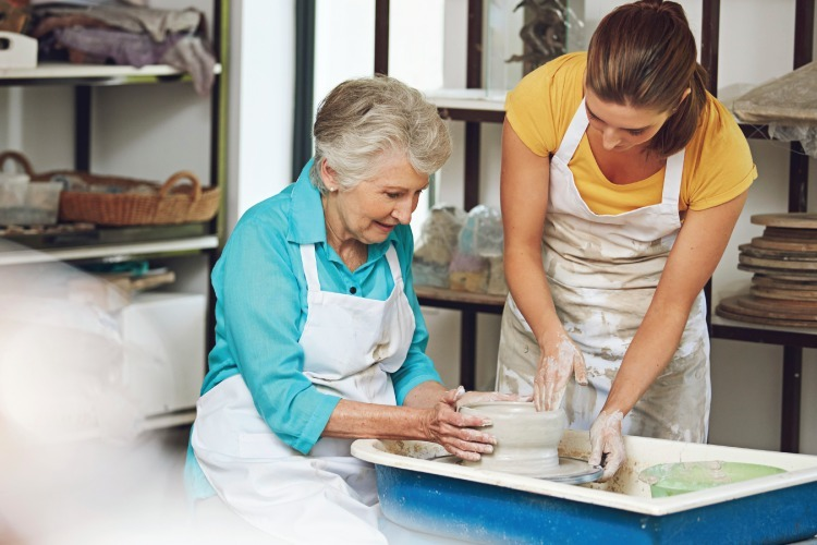 Senior woman in pottery class