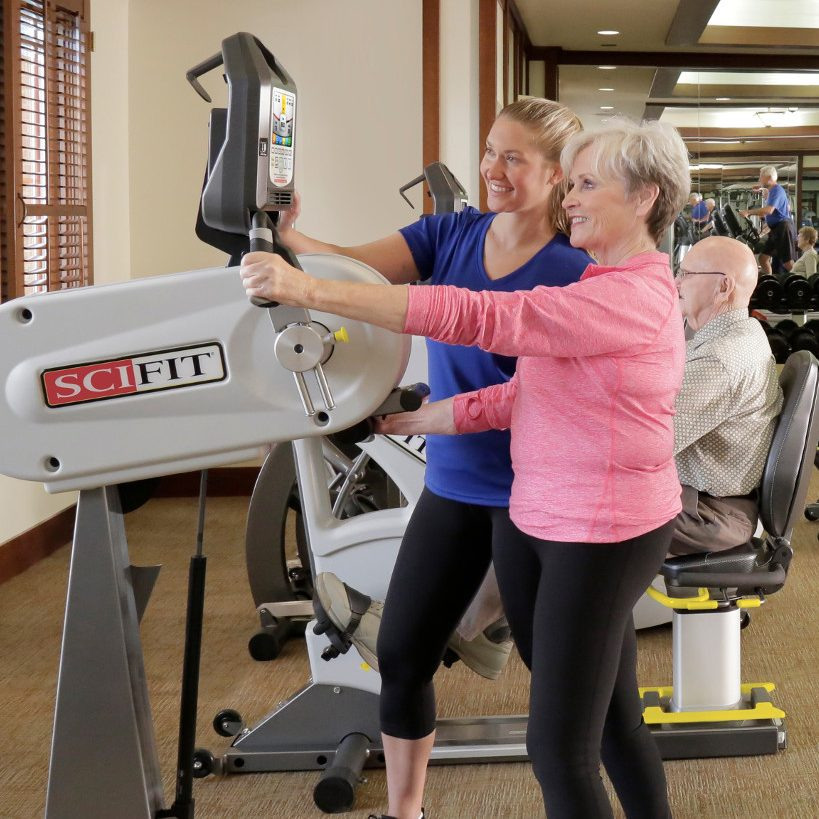 Dr. Sieber helping a member use the SciFit Machine.