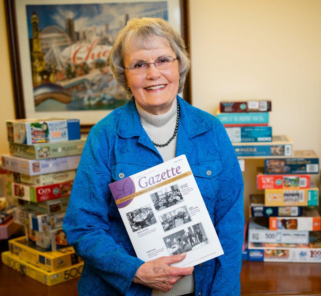 Joyce Carlson holding The Gazette