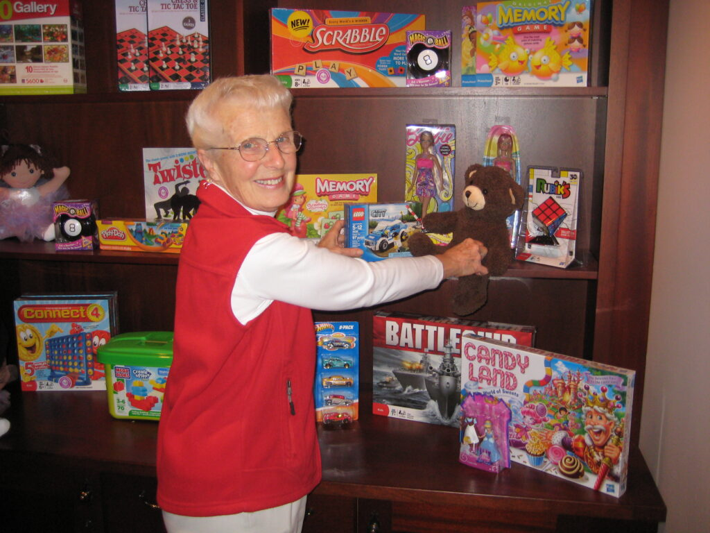 Marlene Peters arranging toys for tots