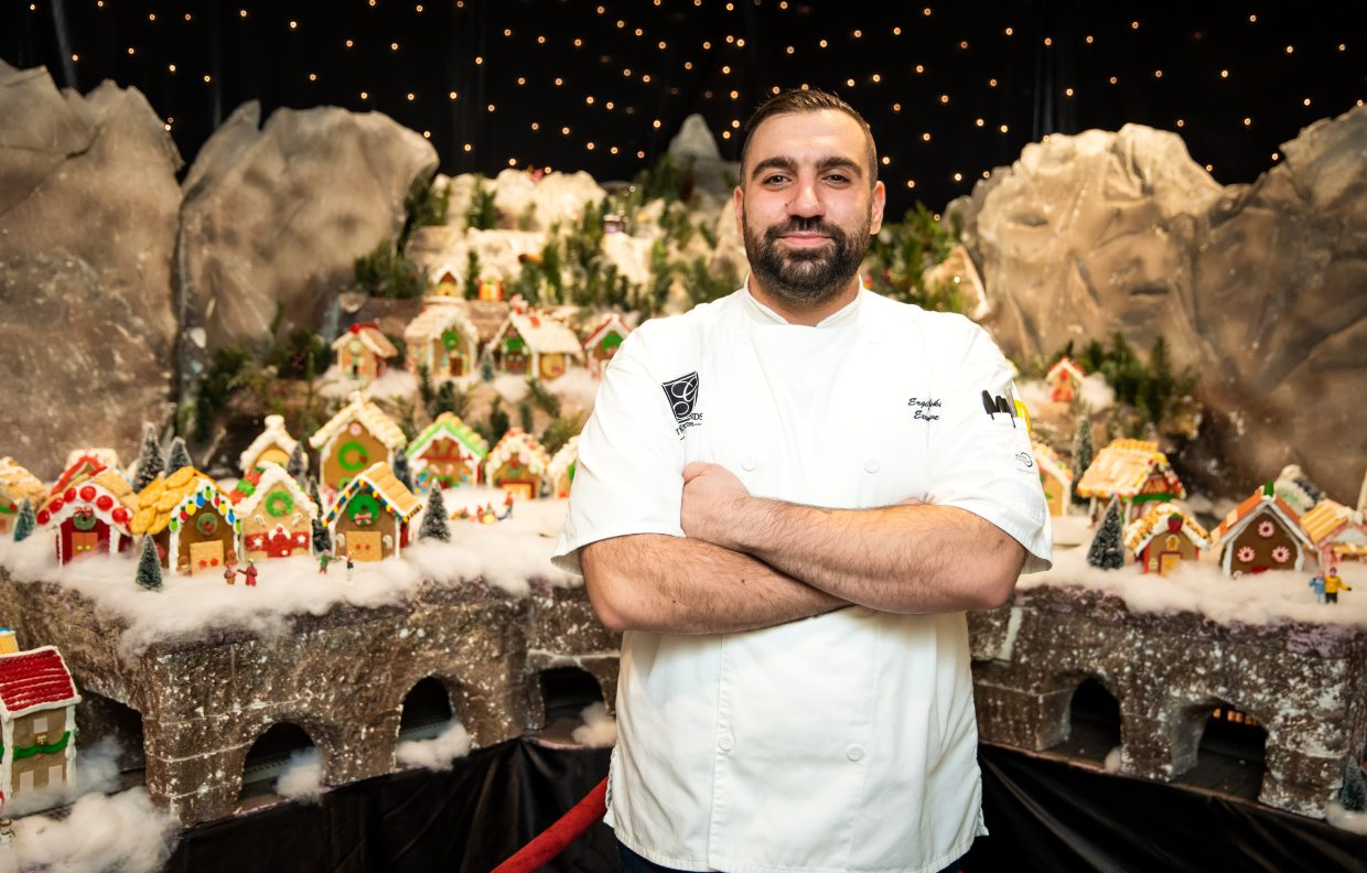 Chef Ergin poses with the Gingerbread Village