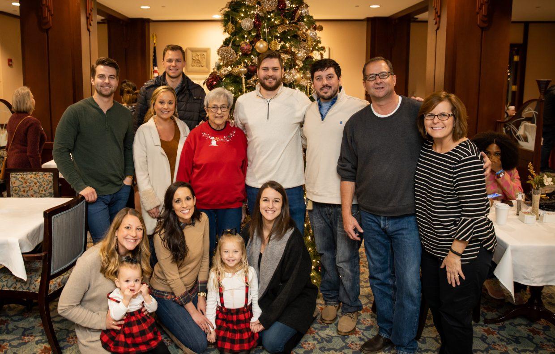 Garlands Member Posing with Family