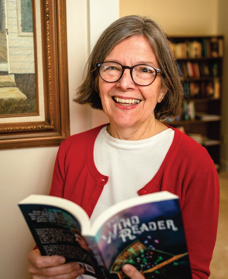 Dorothy Winsor holding a book she wrote.