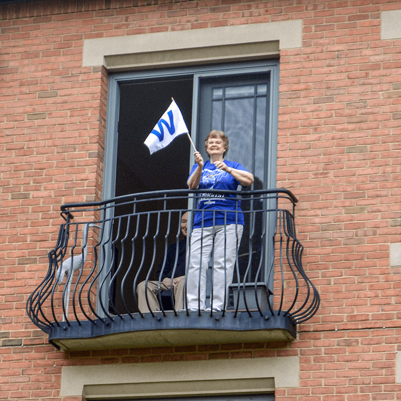 Garlands resident waiving the blue W flag.