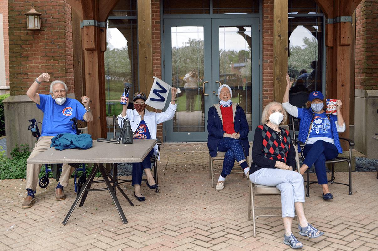 Group of Garlands members cheering in Cubs gear.