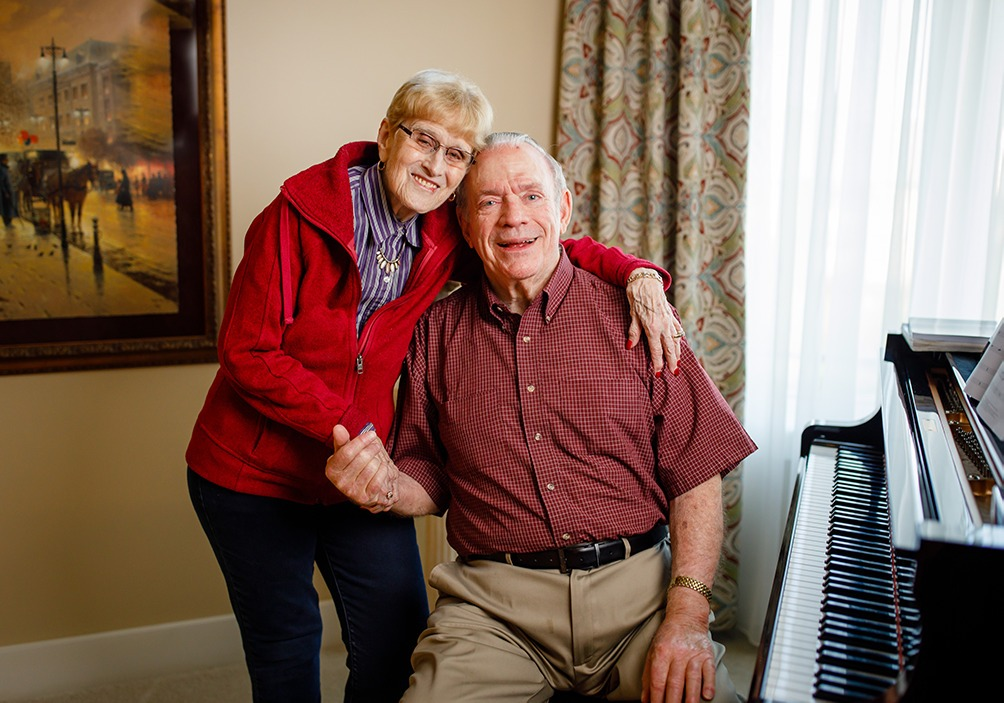 Oliver and Barb Mayes near a piano