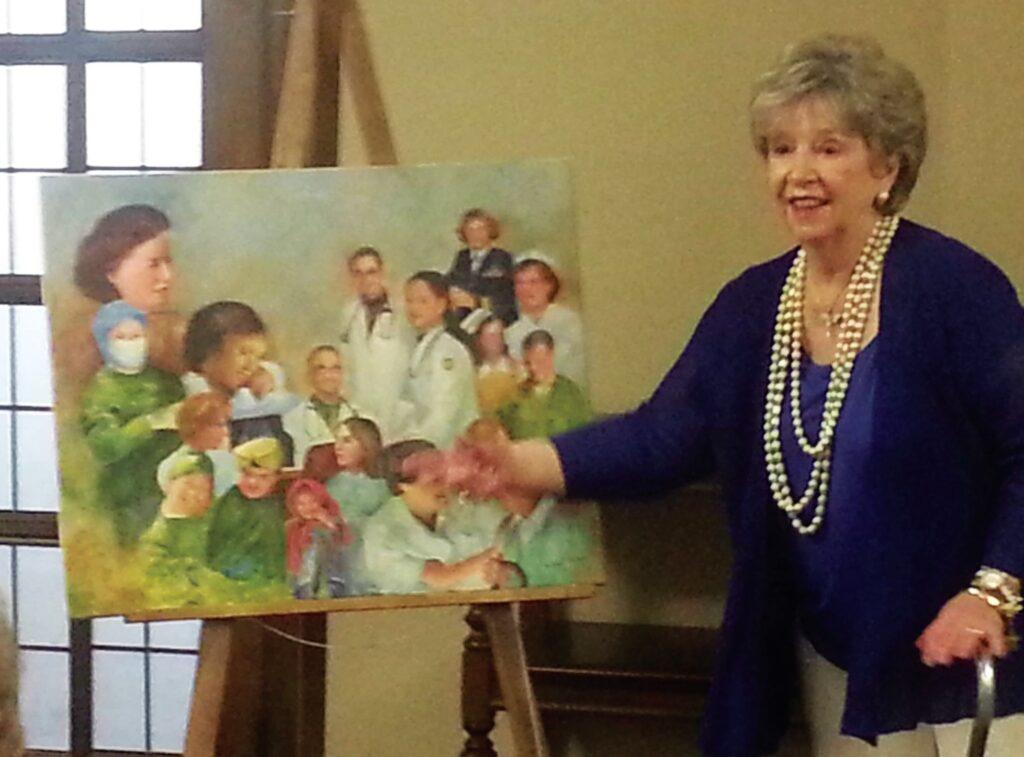 Kathleen L. McCann presenting one of her favorite paintings