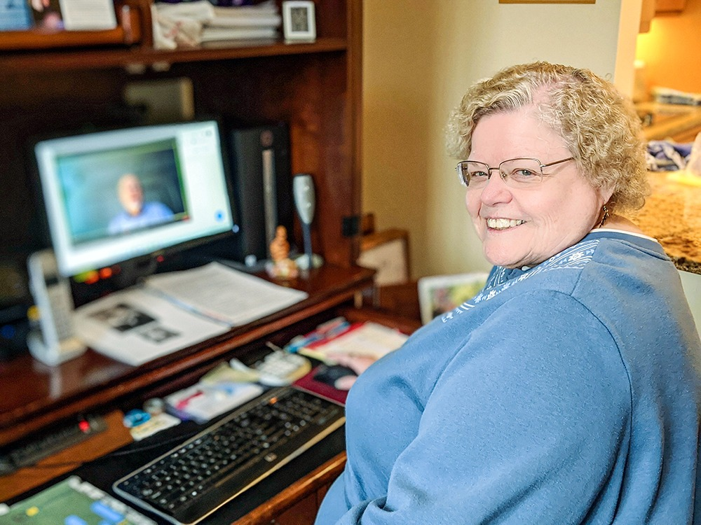 Peggy Clough at her computer