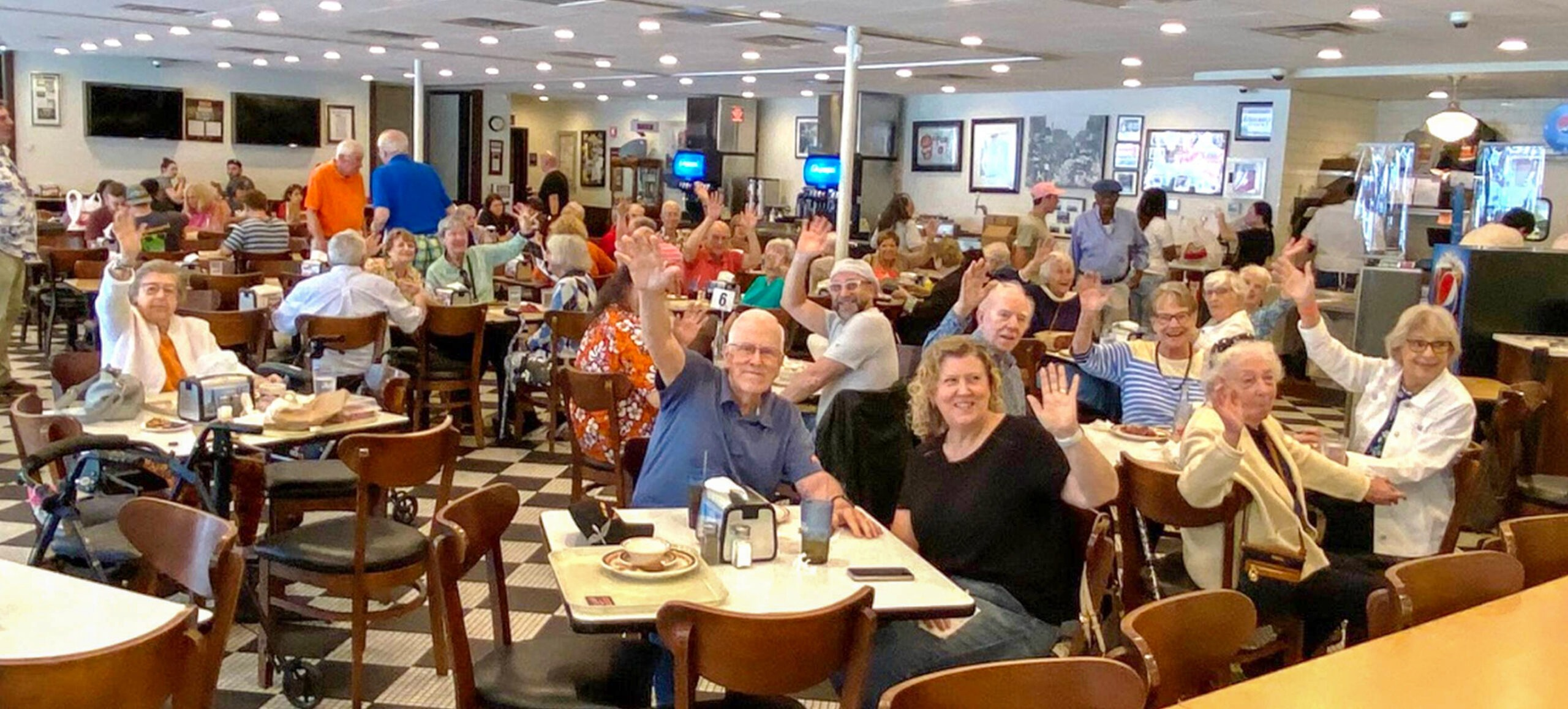 Members dining at Manny's Deli