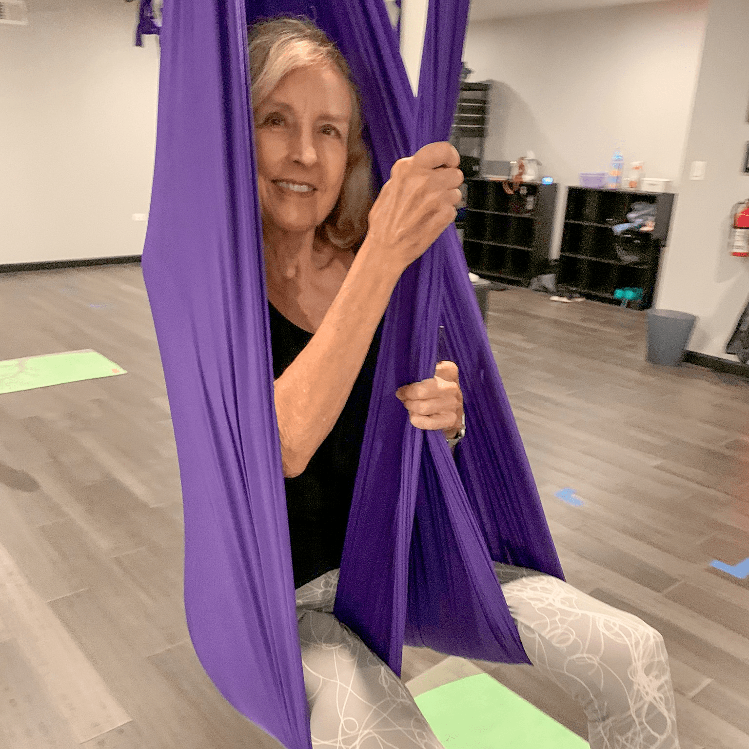 Garlands member, Deanne Born, hangs out at aerial yoga class.