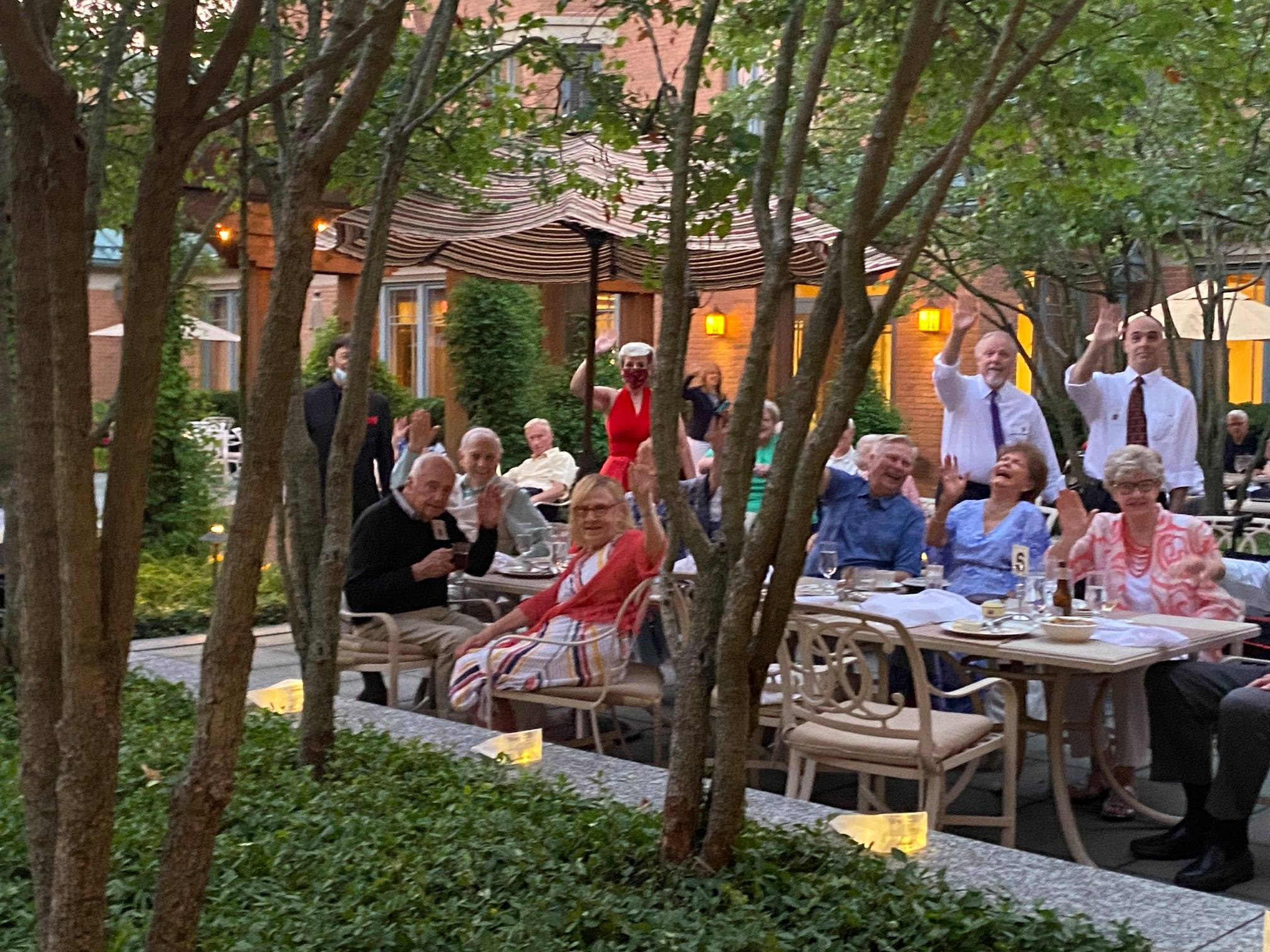 Group of Garlands Members enjoying an outside dining event